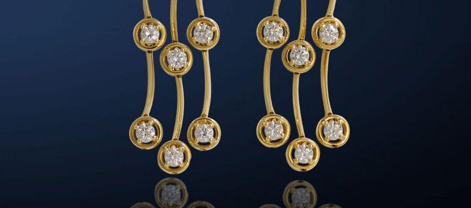 Triple Cascade Diamond Earrings in Yellow Gold